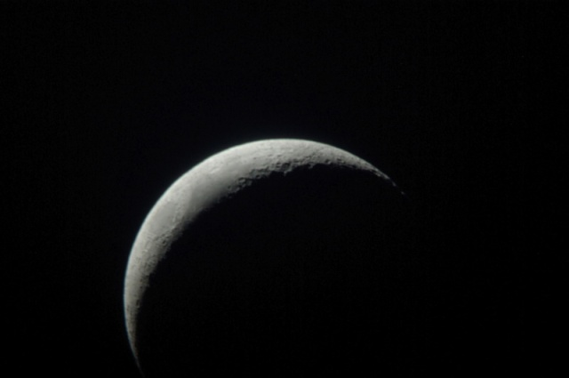 photo of the moon as seen from a telescope